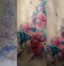 Coverup van een aarsgewijs op de onderrug, de tribal is bedekt met paarse orchideën.