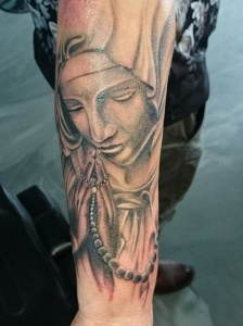 praying woman with chain tattoo