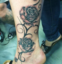 Black and grey rozen tak tattoo