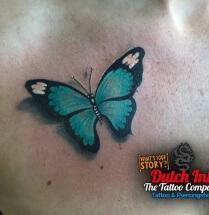 vlinder op borst