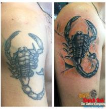 Schorpioen cover-up op bovenarm