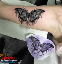 Vlinder op bovenarm