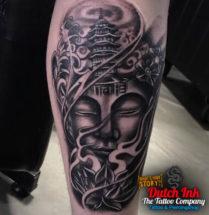 Budda op onderbeen